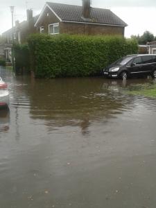 Flooding outside my son's school. Delightful.